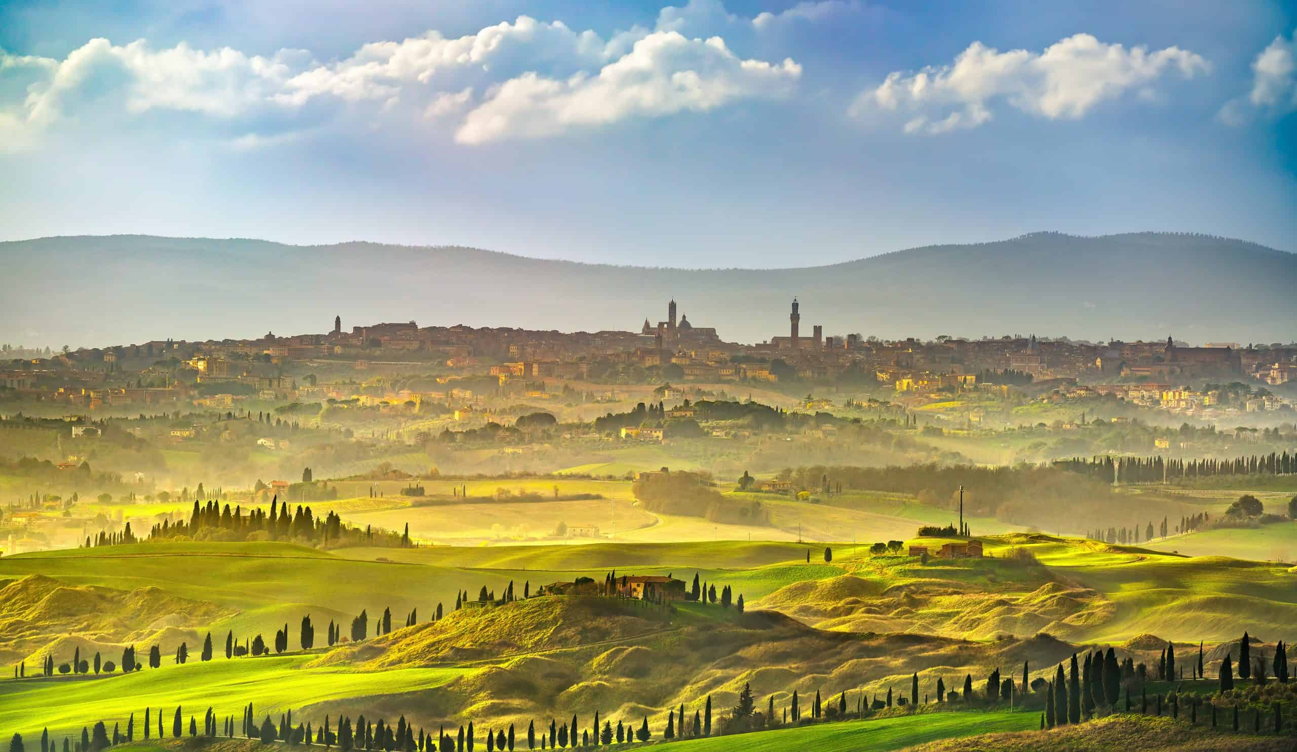 Panorama of beautiful town in Tuscany, Italy with Tuscan countryside in foreground