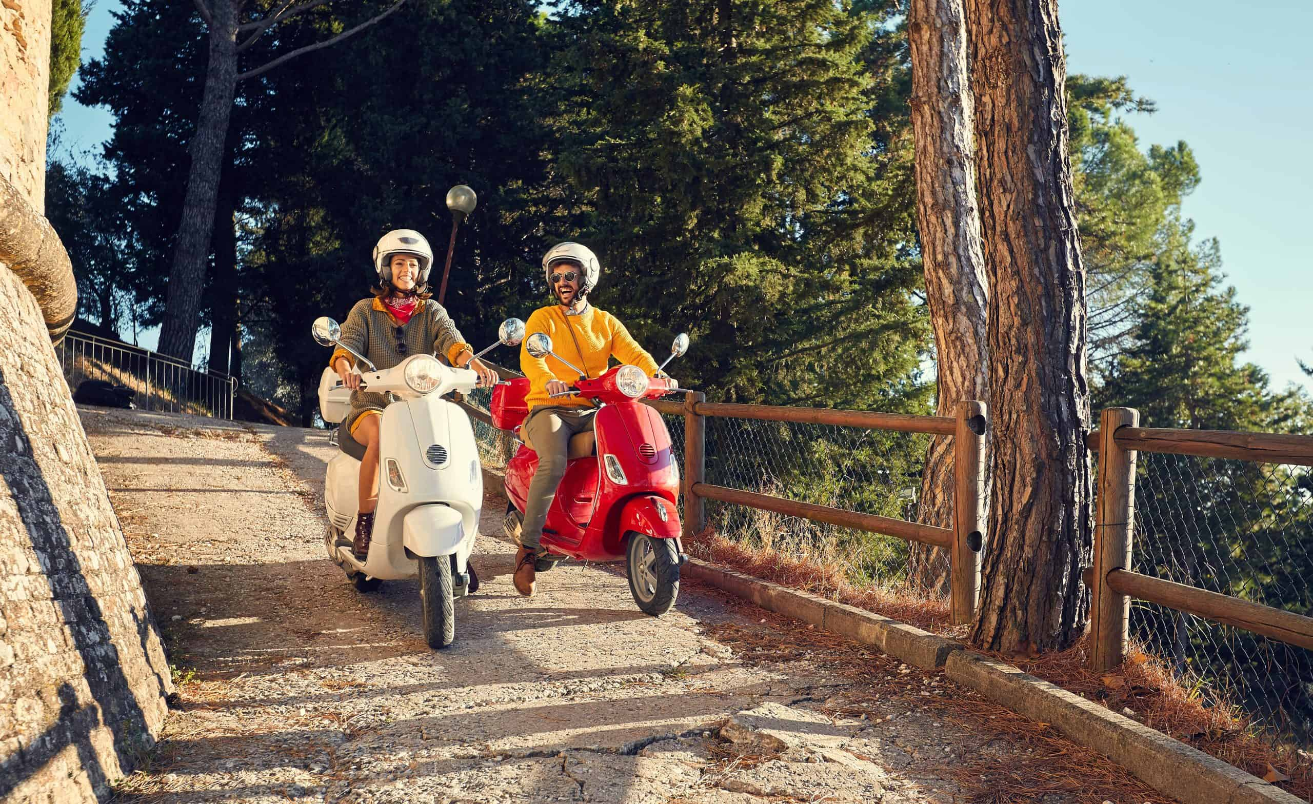 Couple on Vespa tour in Tuscany